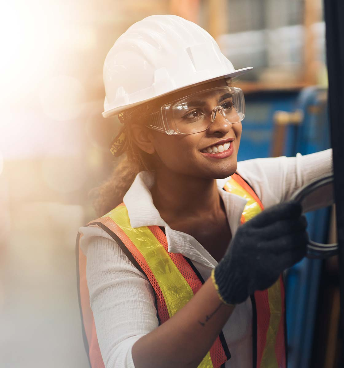Woman wearing personal protection equipment in factory